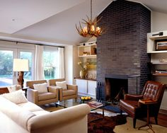 Painted Brick Fireplace in gray or metallic.