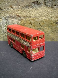 vintage toy red london bus for Raffi's collection.