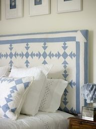Look how they have taken this beautiful blue and white quilt and made it into a headboard.  How perfect is this... the little pillow to match on the bed is perfect.  Then they added the little blue and white pictures above the headboard... perfect!!.......Olde Green Cupboard Designs