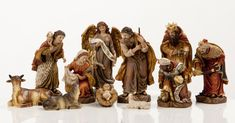 """NEW!  6"""" Heaven's Majesty Nativity Figure Set   Wood carved look, hand-painted in traditional colors. Beautiful 11 piece heirloom quality nativity set. Removable Baby Jesus! This stunning Nativity has some of the finest detail we've seen! The faces on these figures are painted with great care and the quality is visible. Figures are 6"""" tall. (Item #22538)"""