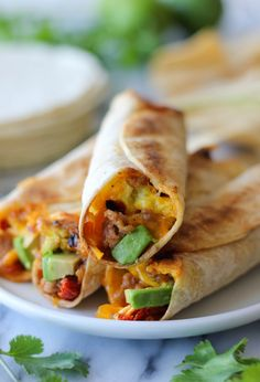 Breakfast Taquitos - Loaded with eggs, sausage, sun dried tomatoes, avocado and melted cheese, you'll have these freezer-friendly breakfast taquitos ready in just 2 minutes!
