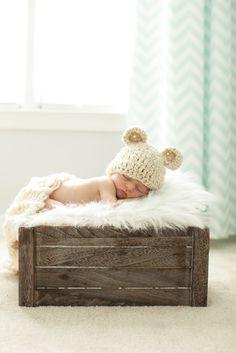 Crate, fuzzy blanket or sheepskin. Hat or no? No low window.