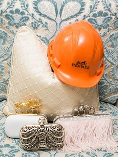 Alexander McQueen clutches (and a Hermes hard hat?)