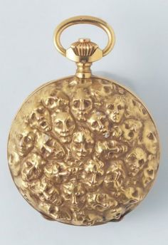 fuckyeahlalique:    Pocket watch. Rene Lalique 91860-1945) Ca. 1900. Yellow gold, classical watch mechanism. Decorated with masks, after a drawing by Rodin. Diam.: 5cm.  The pocket-watchMephistopheles uses to keep his appointments.
