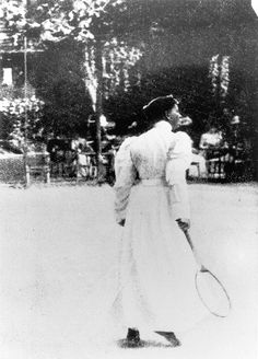 Charlotte Cooper of Ealing, the first woman Olympic champion at the 1900 Paris Olympics, the first Olympics women were allowed to play in.  She had already won 3 Wimbledon titles (and would go on to win 2 more) and beat Hélène Prévost in straight sets to achieve the gold. During the 1900 games Cooper also won gold in mixed doubles. Like many women, Cooper played  in a long  dress with long sleeves. She died at the age of 96 in 1966.