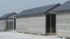 """A private company located in eastern China has printed ten full-size houses using a huge 3D printer in the space of a day. The process utilizes quick-drying cement, but the creators are being careful not to reveal the secrets of the technology. China's WinSun company, used a system of four 10 meter wide by 6.6 meter high printers with multi-directional sprays to create the houses. Cement and construction waste was used to build the walls layer-by-layer, state news agency Xinhua reported.   """"To obtain natural stone, we have to employ miners, dig up blocks of stone and saw them into pieces. This badly damages the environment,""""stated Ma Yihe, the inventor of the printers. Yihe has been designing 3D printers for 12 years and believes his process to be both environmentally friendly and cost-effective.  """"But with the 3D printing, we recycle mine tailings into usable materials. And we can print buildings with any digital design our customers bring us. It's fast and cheap,""""Yihe said. Using"""