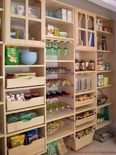 If I were to ever build, I would design a pantry like this one:  pull out drawers and wine glass/bottle storage!