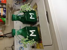 Noise Makers for Football Games. Juice bottles spray painted green.  Rocks inside to make the noise. Ribbons added for color. GO GREEN!!!