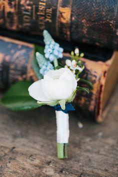 blue and white boutonniere - photo by http://www.loragradyphotography.com/ - http://ruffledblog.com/georgia-peach-wedding-inspiration/