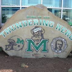 Marshall University rock outside of the facility building on 3rd Avenue.