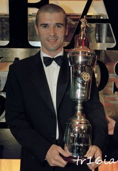 Roy Keane with the Professional Footballers Association Player of the Year Award for the 1999-2000 season.  The award is voted on by members of the players' union and is given to the best player in English football.