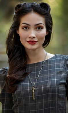 subtle victory rolls-.. like the dark hair with simple complexion and red lip