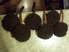 Princess Leia buns made from yarn.  There are tutorials and youtube videos out there explaining how to make these.