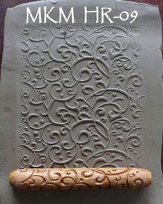 Hand roller stamp curls pottery ceramics clay   http://mkmpotterytools.com/