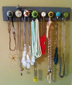DIY knob necklace holder: this is exactly what I need!  Hobby Lobby has great knobs.