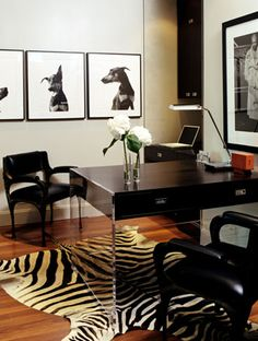 This bold, yet understated space is a new twist on the masculine office. The office boasts an acrylic table, accented by a zebra rug breaking up the room.