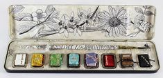 Beautiful tiny books as watercolors by Lesley Patterson-Marx.