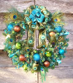 Funky Feathered Fun Animal Print Peacock Feathers Brown Turquoise Lime Glitter Christmas Ornament Ball Ribbon Wreath.  via Etsy.