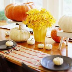 Put pumpkins on pedastals--literally--for a quick display. See more beautiful Thanksgiving centerpieces: www.bhg.com/thanksgiving/indoor-decorating/easy-centerpieces-for-thanksgiving/?socsrc=bhgpin100512thanksgivingpumpkincenterpiece#page=15