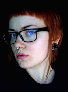Septum and Nostril Piercing, Stretched Ear Lobe