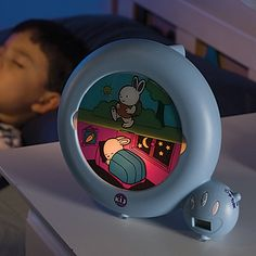 """KIDSleep Toddler Clock.  """"It could be argued this is more a present for the parents (who might need a full nights' sleep after someone's been drumming all day). This alarm clock teaches kids about time; specifically what time is too early to wake everyone up. If the bunny is still sleeping, you should be too."""""""