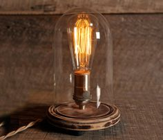Rustic bell jar with a satin Nickel light socket, cloth covered wire and inline switch. with Edison style bulb