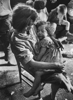 A poverty-stricken family in Appalachia. Photograph by John Dominis. Kentucky, 1964.