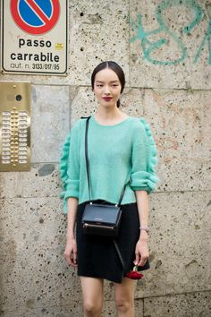 Fei Fei Sun Save this for your fall outfit inspiration — the deep lip and mint-green sweater work beautifully together.  Photo: I'M KOO