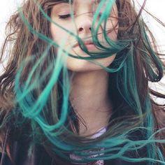 Brown hair, blue/green tips.