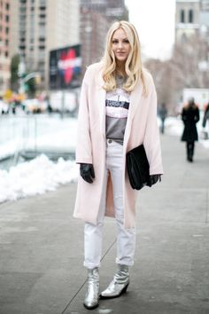 The best street style at NYFW F/W 2014 #ElleMagazine #fashion #streetstyle #pastels fw2014, street style, coat