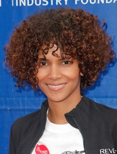 Halle Berry traded in her short cut for a curly bob and we're loving the new look.