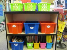 In one section of his reading area, first-grade teacher Andrew Pitman stores books with different size tubs that correspond with the type and size of the book. There is a freestanding rack for popular picture books on the right, baskets for paperback series books like Fancy Nancy on the top, bigger containers for nonfiction science books in the middle and smaller upright holders for magazines and class-made books on the bottom.