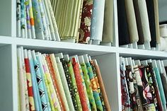 I can't wait to try this: Organize fabric and store it better than in stacks and piles on shelves. It looks like it would be easier and faster to find the material I want.