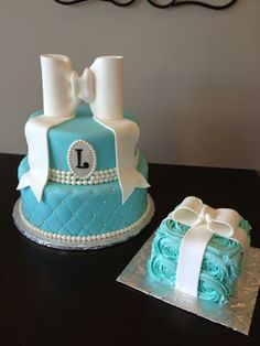 Tiffany style first birthday cake with matching smash cake. Large fondant bow, quilted base and monogram.