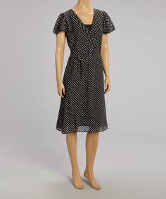 Loving this Black & White Polka Dot Surplice Dress on #zulily! #zulilyfinds