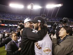 San Francisco Giants manager Bruce Bochy (15) congratulates  San Francisco Giants starting pitcher Madison Bumgarner (40) as they win their third World