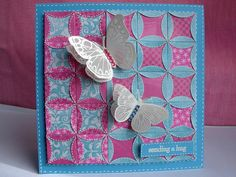handmade quilt card: Patchwork and Butterflies by heather maria ... luv the folded edge circle design creating flowers sowing the back sid of the paper in pretty flowers ... delightful vellum butterflies with raised wings on top ... great card!!