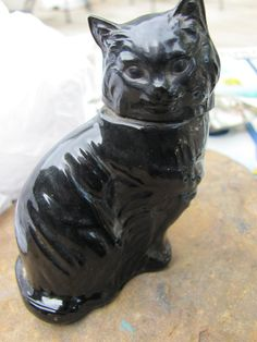 Black Avon Cat Perfume Bottle. I used to have the white one too.