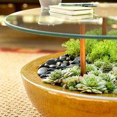 deck decorating ideas glass table planter succulents river pebbles