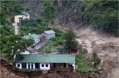 Buildings stand on floodravaged land alongside the River Alaknanda in Chamoli district in the northern Indian state of Uttarakhand on June 18, 2013.