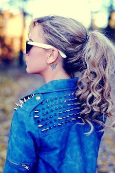 Curly pony , spikes, behind ear tattoo, ray bans, blue jeans