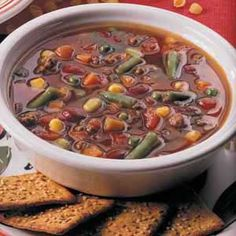 Easy Vegetable Beef Soup  1 lb ground beef  1 onion, chopped  1 can (28 oz) diced tomatoes, undrained  1 pkg (16 oz) frozen veggies  1 can (16 oz) kidney beans, undrained  1 can (14-1/2 oz) beef broth  1 envelope taco seasoning  1 garlic clove, minced  In a large saucepan, cook beef & onion over medium heat; drain. Add tomatoes, vegetables, beans, broth, taco seasoning & garlic; bring to a boil. Reduce heat; simmer, uncovered, for 10 minutes. Yield: 10-12 servings (2-3/4 quarts).