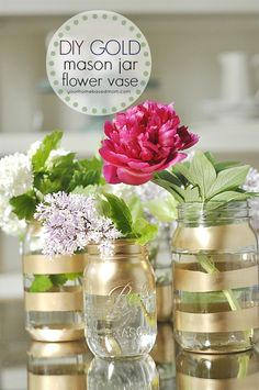 gold spray paint on mason jars (w blue tape/newspapers over what not to be painted).  would look really cute with various stripe sizes.