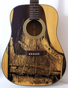 Drawings on guitars by Patrick Fisher