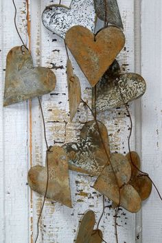 DIY wedding garland distressed rusty metal hearts romantic shabby chic home decor Anita Spero --think I could make this with hearts cut from tin cans and rusted and faux barbed wire.