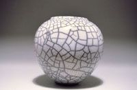 Example: Ferguson's White Crackle Raku Gerstley Borate	65% Nepheline Syenite	15 Tennessee Ball Clay	 5 Tin Oxide	10 silica	5  	100%