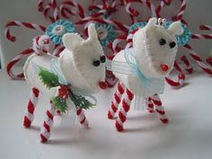 Peppermint Reindeer made of felt with twisted pipe cleaner candy cane legs.