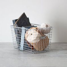 BASKETS :: Vintage books & twine in a locker basket. | #sweetmagnoliaway