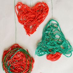 Your little ones will love learning how to make Christmas decor when they craft these Glittery Yarn Christmas Ornaments! Homemade Christmas ornaments have never been this much fun.   AllFreeKidsCrafts.com