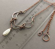 Layered scallop shape copper necklace with white glass pearl drop pendant, by Inna Gor